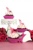Pink cupcakes with high heel shoes — Stock Photo