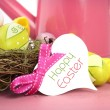 Happy Easter watering can, flowers and easter eggs. — Stock Photo #65410775