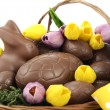 Happy Easter chocolate bunnies and eggs in hamper basket. — Stock Photo #65410927