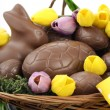 Happy Easter chocolate bunnies and eggs in hamper basket. — Stock Photo #65411049