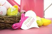 Happy Easter watering can, flowers and easter eggs. — Stock Photo