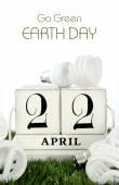 Earth Day, April 22, concept with energy saving light bulbs. — Stock Photo