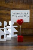 International Childrens Day concept with paper dolls. — Stockfoto