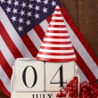 Fourth of July vintage wood calendar with flag background. — Stock Photo #75853469