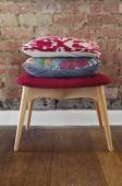 Homewares cushions on ottoman stool — Stock Photo