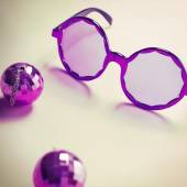 Purple sixties glasses with mini disco ball earrings — Stock Photo
