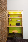 Lime green feature wall study nook in living room — Stock Photo