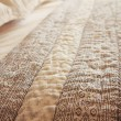 Close up of luxury bed quilt cover and pillows horizontal — Stock Photo #63549573