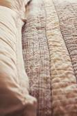 Close up of contemporary luxury bed quilt cover and pillows — Stock Photo