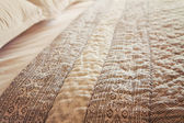 Close up of luxury bed quilt cover and pillows horizontal — Stock Photo