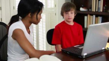 Tutor going over a boys studies — Stock Video