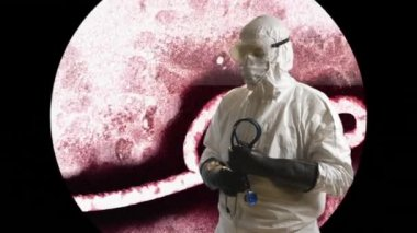 Ebola doctor in front of a microscope view of the ebola virus — Stock Video