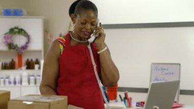 Shop owner receives a troubling phone call — Stock Video