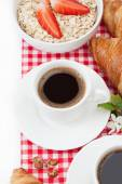 Coffee cup, croissant, oatmeal with strawberries and a sprig of — Stock Photo