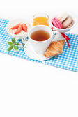 Tea cup with croissant, colourful french macaroons in vase  fest — Stock Photo