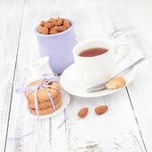 Breakfast with homemade cookies, apple and almond with cup of te — Stock Photo