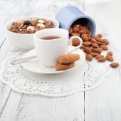 Breakfast with homemade cookies, oat and almond with cup of tea — Stock Photo
