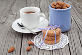 Chocolate chip cookies and almond with cup of tea — Stock Photo