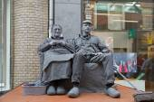 Arnhem, Netherlands - September 28, 2014: artists depict old couple during world championships living statues in Arnhem — Stock Photo