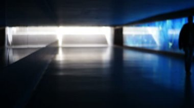 Blue illuminated underpass, subway - people walking by — Stock Video