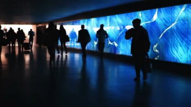 Blue illuminated underpass, subway - people walking by — 图库视频影像