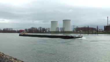 Container ships in front of nuclear power plant Biblis — 图库视频影像