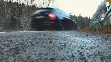 Passing car, bad road conditions — Stock Video