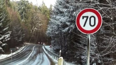 Road warning sign - speed limit 70 — Stock video