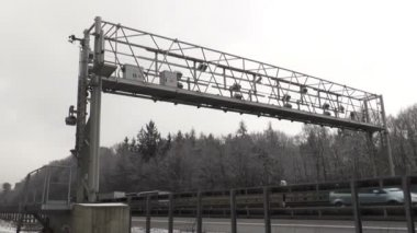 Trucks pass a control gantry of german truck toll system — Stock Video