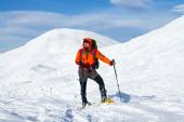 Hiker in winter mountains — Stock Photo