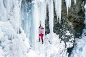 Man climbing frozen waterfall.Ice climbing the North Caucasus. — Stock Photo