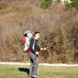 Father is hiking with the 1.5 year baby in baby carrier — Stock Photo #65426701