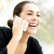 Delighted young woman listening to a phone call — Stock Photo #73002007