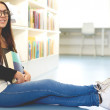 Smiling young student relaxing on campus — Stock Photo #73002951