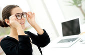 Young businesswoman adjusting her glasses — Stock Photo
