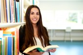 Positive hard-working student holding an open book — Stock Photo