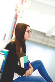 Thoughtful young woman student — Stockfoto