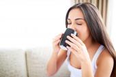 Close up of woman enjoying a warm drink. — Stock Photo