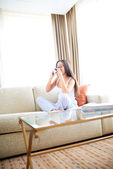 Woman enjoying a warm drink and relaxing. — Stock Photo
