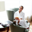 Woman sitting in chair relaxing — Stock Photo #73235239