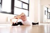 Ballerina Splitting Legs While Reaching her Toes — Stock Photo