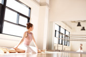 Ballerina Admiring Reflection of Self Doing Splits — Stock Photo