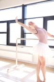 Ballerina Doing Barre Exercises in Sunny Studio — Stock Photo