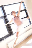 Young Ballerina Leaping Through Air in Studio — Stock Photo