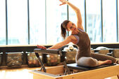 Attractive brunette in pilates class — Stock Photo