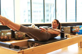 Brunette Woman Practicing Pilates in Studio — Stock Photo