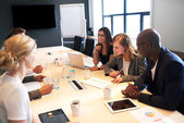 Group of young executives having a work meeting — Stock Photo