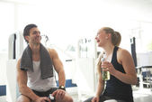 Healthy Couple Relaxing After Workout In the Gym — Stock Photo