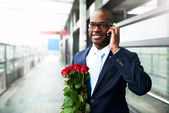 African American holding a bouquet of roses — Stock Photo