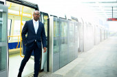 Black American Businessman Going Out From a Train — Stock Photo